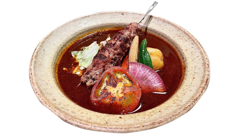 56. ポニピリカ<br>ラムカバブと炙りトマトのカレー